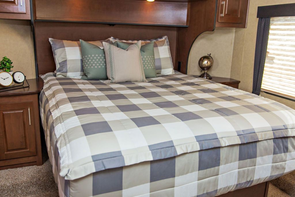 Adding new bedding to your RV's bedroom can really spruce up the space.