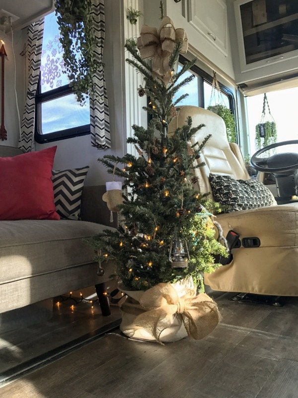 Decorate a smaller Christmas tree to accommodate for the smaller space.