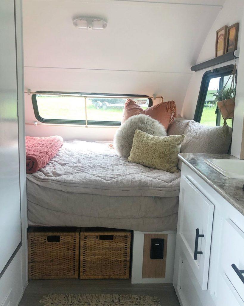 Painting your RV bedroom a light color really opens up and brightens the space.