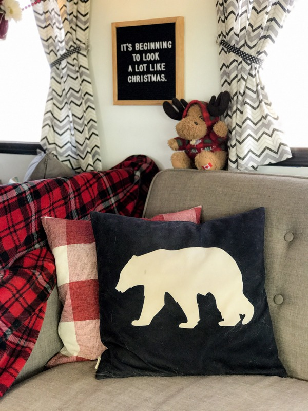 Cover your pillows in decorative Christmas covers for maximum festivity.