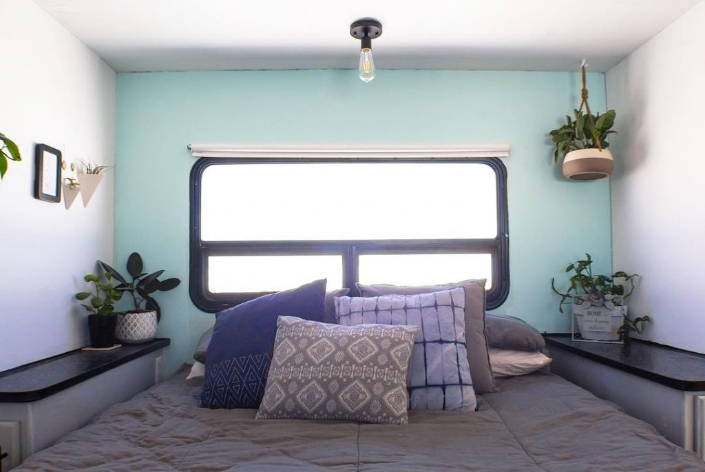 Adding throw pillows and a blanket can change the overall look of your RV's bedroom.