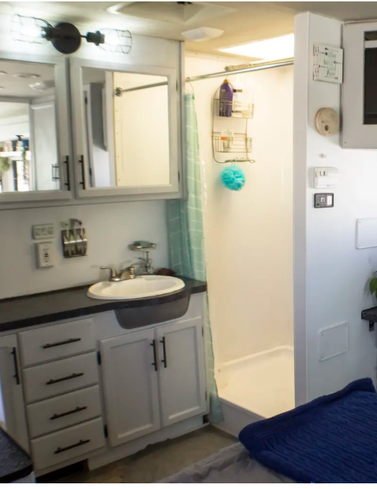 Installing a shower curtain will open up the room and make it look more modern.