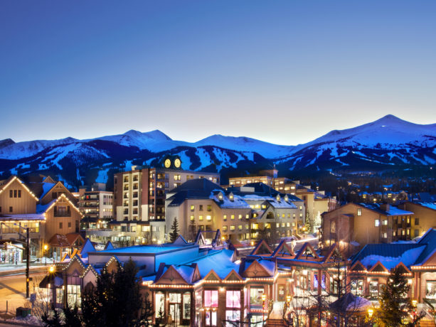 The town of Breckenridge, Colorado is lovely when it is illuminated at night with a mountain in the background.