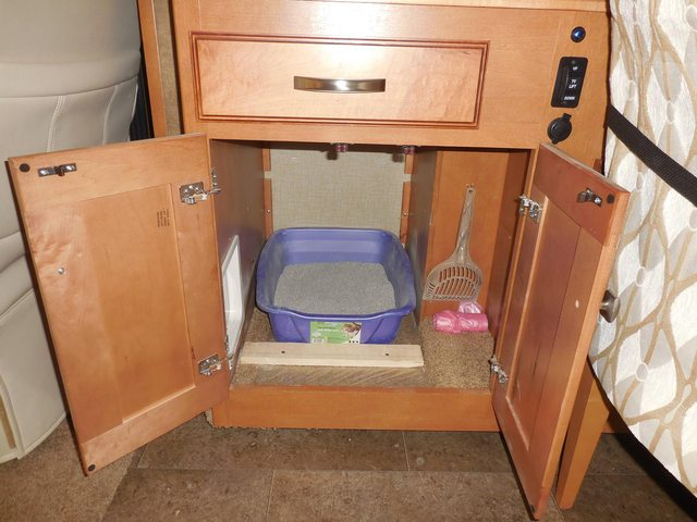 A built in litter box can make traveling with our cat much easier.