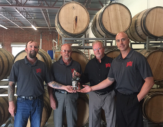 Van and John Williams reopened the distillery in 2015 with their sons Matt and Zeb.