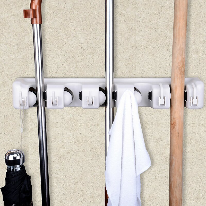 Use a mop and broom holder to organize your cleaning supplies.