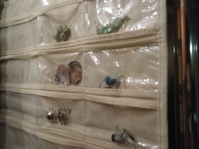 Organizing jewelry in a small space is simplified with hooks.
