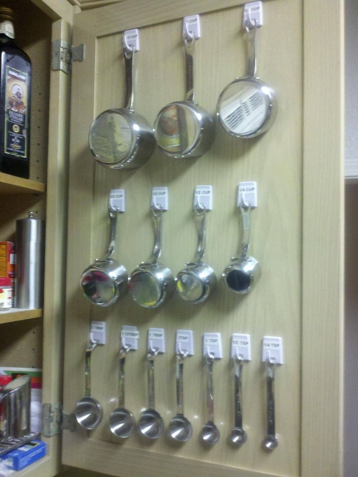 Individually-hanging measuring cups and spoons is a great place to start when organizing a small space.