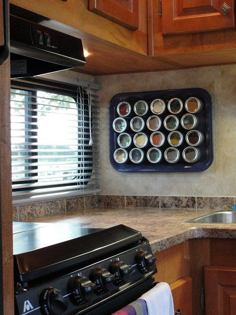 Mount a magnetic rack to the kitchen wall to organize your spices.