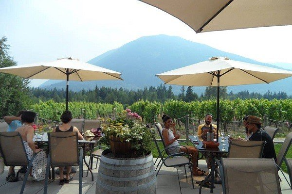 The winery operates a tasting room, a wine bar, and an outdoor patio.