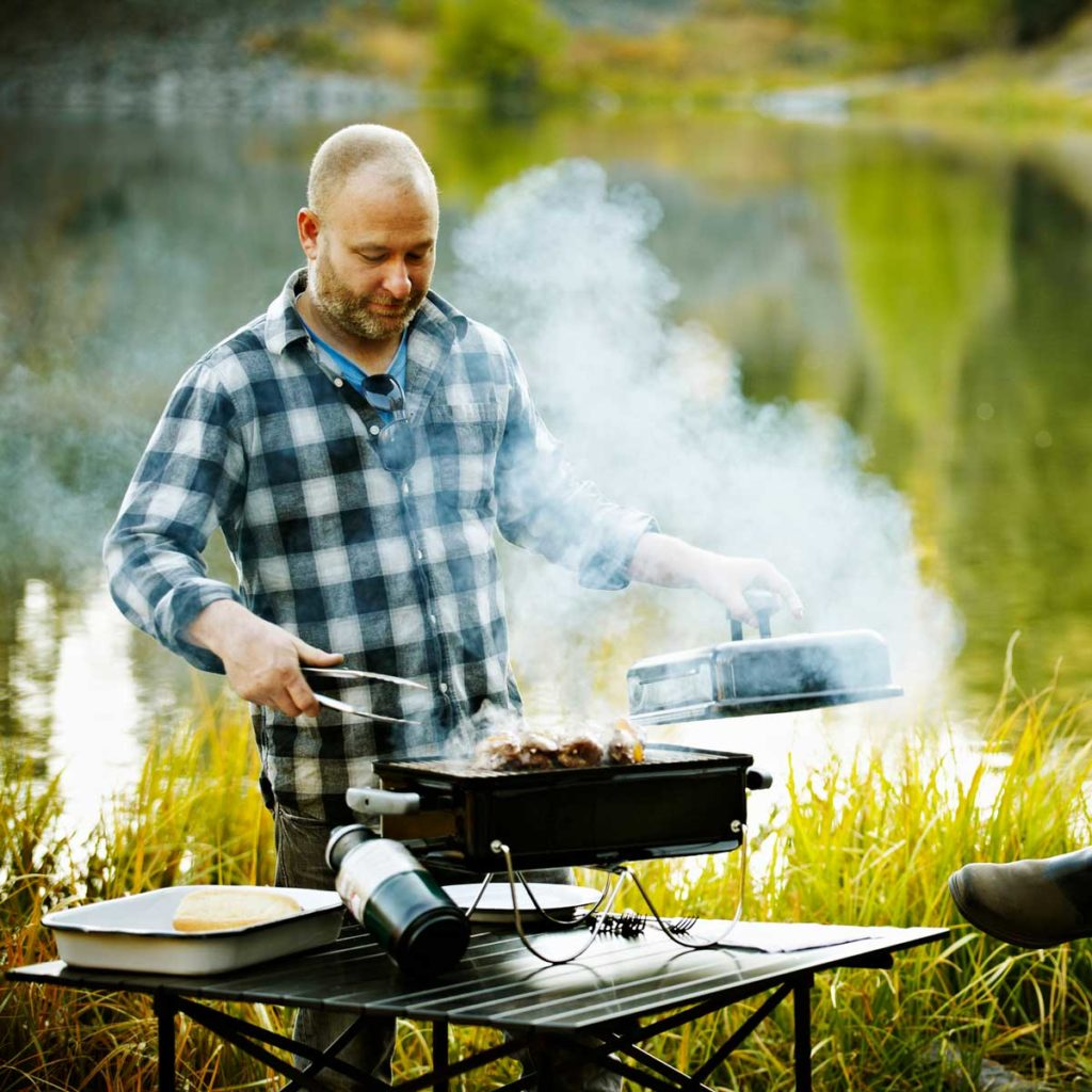 man grilling outside