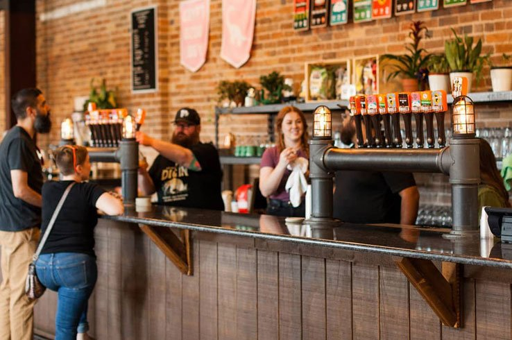 The Armadillo Ale Works taproom has several beers on tap and plenty of customers.