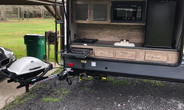 Outdoor RV grill mounted next to an outdoor kitchen