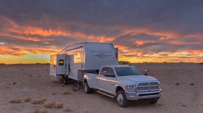 A fifth wheel RV at sunset