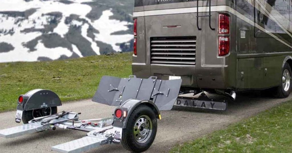 Tow dolly towing utilizes a tow dolly with ratchet straps.