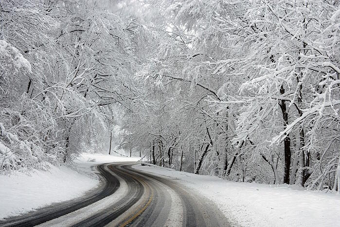 Icy and snowy roads can make for difficult driving conditions.