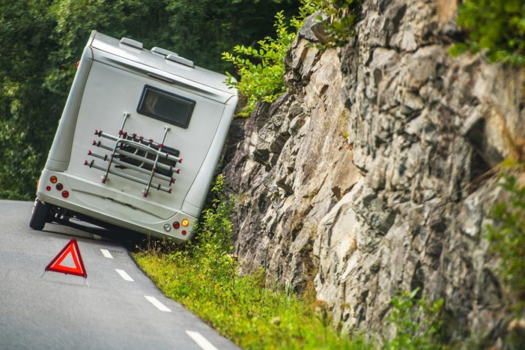 Motorhome that has pulled off the side of the road and is utilizing hazard triangles