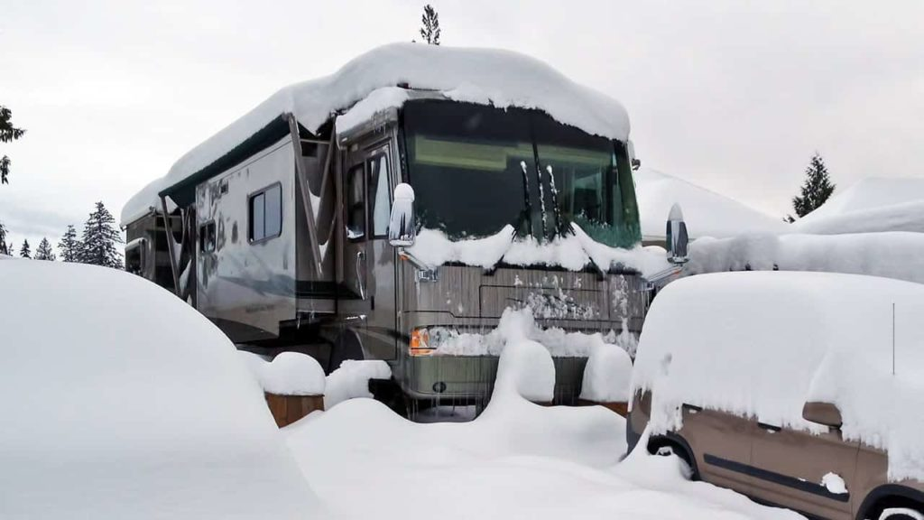 A motorhome covered in snow