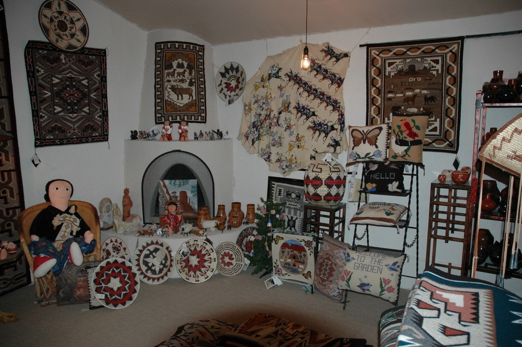 An inside-look at some of the crafts available for purchase. The walls and floor are adorned in Native American crafts.