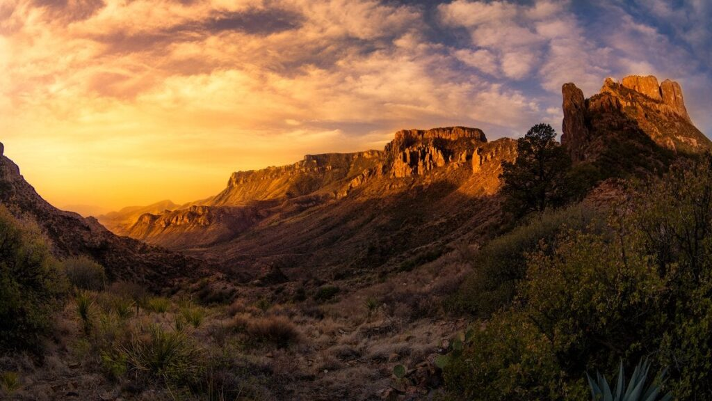 a beautiful sunset with a desert butte in big bend national park