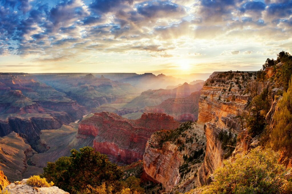 The sun shining bright over the grand canyon