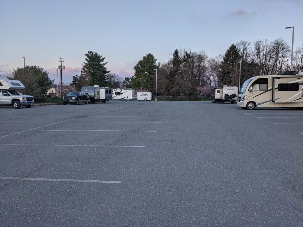 RVs are permitted to park overnight in the back lot.