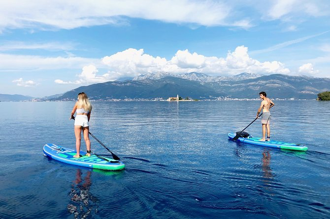 Stand-up paddle-boarding is a great way to stay fit on the road.